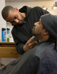 Freedom-Allah getting his beard shaped by a barber.