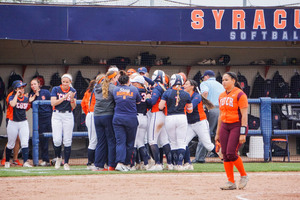 Syracuse crowds second baseman Alicia Hansen after her walk-off single on Saturday afternoon.