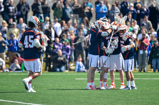 Syracuse players celebrate a goal.